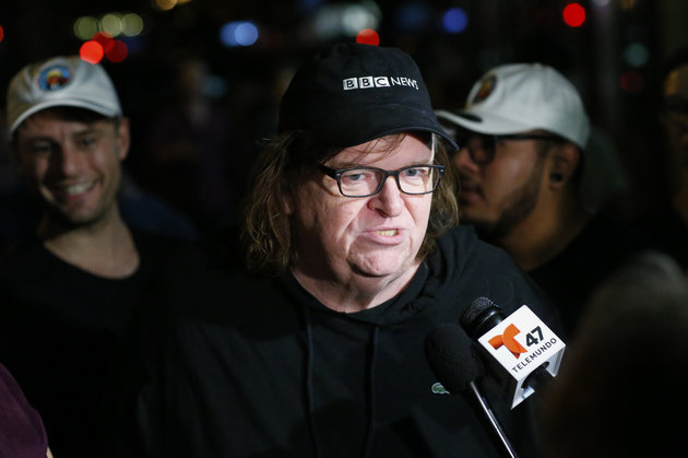 "US filmmaker Michael Moore speaks with members of the media as he arrives at the IFC Theater before the debut of a surprise documentary about Republican presidential nominee Donald Trump titled ""TrumpLand"" in New York on October 18, 2016.   / AFP / KENA BETANCUR        (Photo credit should read KENA BETANCUR/AFP/Getty Images)"